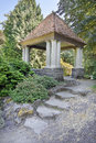Gazebo with natural stone steps at public garden Royalty Free Stock Image