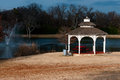 Gazebo near a fountain in the winter beautiful white during pond and Royalty Free Stock Photography