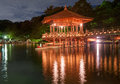 Gazebo nice japanese wooden is shortly after the sunset reflecting in the water nara japan Royalty Free Stock Image