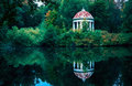 Gazebo Rotunda in the park by small pond Royalty Free Stock Photo