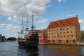 Gdansk city editorial view of the main canal with hotel philharmonic hall and old touristic ship summer season on baltic sea Stock Photos