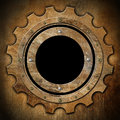 Gear brown rusty metal porthole metallic shaped with black hole window Stock Photo