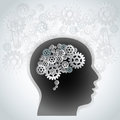 Gear wheel brain silhouette of human s head with made of connected wheels of different shapes on gray back ground Royalty Free Stock Image