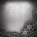 Gear wheels on steel background Stock Photography