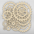 Gears from clock works over grey metalic plate