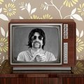 Geek mustache tv presenter in retro tv Royalty Free Stock Photo