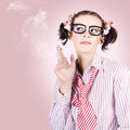Geek in stress smoking cigarette on pink copyspace in a smoke break concept Stock Photo