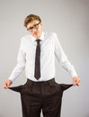 Geeky businessman showing his empty pockets Royalty Free Stock Photo