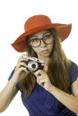 Geeky girl with camera in red hat pposing antique Royalty Free Stock Photography
