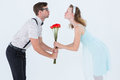 Geeky hipster couple holding roses and kissing Royalty Free Stock Photo
