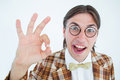 Geeky hipster doing the ok sign on white background Royalty Free Stock Image