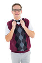 Geeky hipster fixing his bow tie Royalty Free Stock Photo