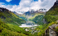 Geiranger fjord norway beautiful nature it is a kilometre mi long branch off of the sunnylvsfjorden which is a branch off of the Royalty Free Stock Photo
