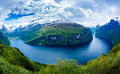 Geiranger fjord norway beautiful nature it is a kilometre mi long branch off of the sunnylvsfjorden which is a branch off of the Royalty Free Stock Photos