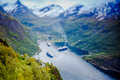 Geiranger fjord norway beautiful nature tilt shift lens it is a kilometre mi long branch off of the sunnylvsfjorden which is a Stock Photo