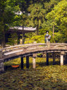 Geisha at chion in temple japan a japanese standing on an ornamental bridge the gardens of the city of kyoto Stock Photo