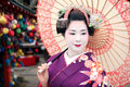 Geisha and umbrella Royalty Free Stock Photo