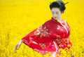 Geisha in the yellow field Royalty Free Stock Photo