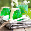 Gelatin dessert with woodruff on wooden ground Stock Image