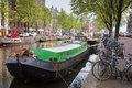 Geldersekade canal in amsterdam boats and bikes on waterfront holland Stock Photography