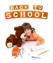 Gelukkig weinig jongen met notitieboekje en teddybeer Royalty-vrije Stock Afbeeldingen