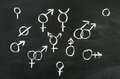 Gender s the different sign draw on blackboard Stock Photos