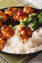 General Tso's chicken with rice for dinner. vertical, macro Royalty Free Stock Photo