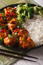 General Tso's chicken with rice, onions and broccoli closeup. ve Royalty Free Stock Photo