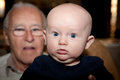 Generations baby in the forefront with his grandfather in the background image orientation is horizontal and there is copy space Royalty Free Stock Photos