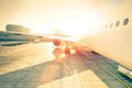 Generic airplane on terminal gate ready for takeoff at airport Royalty Free Stock Photo