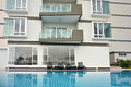 Generic condominium outdoor with swimming pool view of Royalty Free Stock Image