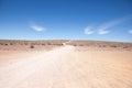 Generic desert scene with path to horizon Royalty Free Stock Photo