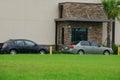 Generic drive thru pickup window with cars Royalty Free Stock Photo