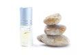 Generic perfume and zen stone white background Stock Photo