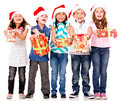 Generous Christmas kids Royalty Free Stock Photos