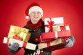 Generous santa portrait of happy man in cap with giftboxes looking at camera Stock Photo