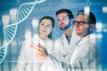Genetic engineering group of geneticists working at media screen Stock Image