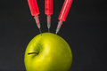 Genetic manipulation with an apple Royalty Free Stock Photo