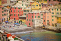 Genoa, Italy - bathers on the small shore of the Boccadasse bay Royalty Free Stock Photo