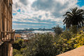 Genoa landmark landscape with antique lighthouse and harbor. Royalty Free Stock Photo