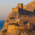Genoese fortress medieval on the shore of the black sea the crimean peninsula ukraine toned image Royalty Free Stock Images