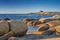 Genoese tower at Punta Caldanu in Corsica Stock Image