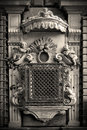 Genova cherub facade and window with grate in the old church italy Stock Photography