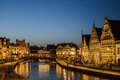 Gent night belgium the tourists at the shore of one of the canals and the historical buildings lit at Stock Images