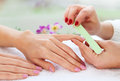 Gentle care of nails in a beauty salon the close up Stock Image