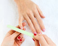 Gentle care of nails in the beauty salon close up Royalty Free Stock Photo
