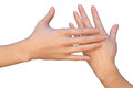 Gentle female touch by hand a closeup of a hands that are touching each other very gently a woman is holding a palm of her next to Stock Photo