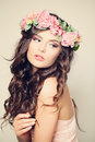 Gentle floral portrait of woman fashion model curly hair beauty makeup and peony flowers Stock Photos