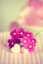 Gentle pink flower and heart on table shallow depth of field Royalty Free Stock Images