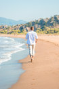 Gentle stroll along the beach barefoot Royalty Free Stock Photo